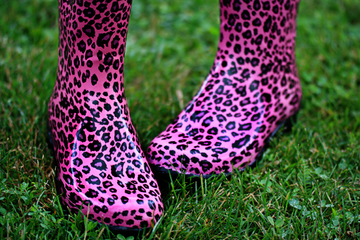 pink leopard wellington wellies boots on dark green grass
